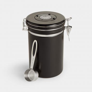 black airtight coffee canister made from stainless steel with spoon