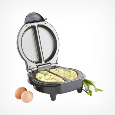 electric omelette maker with a cooked omelete inside